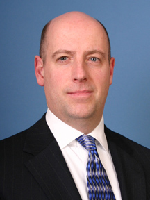 Joe McHugh, former Navy officer and EY Executive Director
