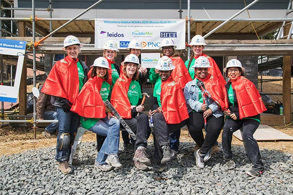 Freddie Mac women participate in a Habitat for Humanity of Northern Virginia Women Build to support the local community.